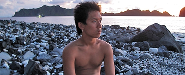 Dennis Chan prepares to overnight on the island of Maug (Photograph by Patrick Symmes)