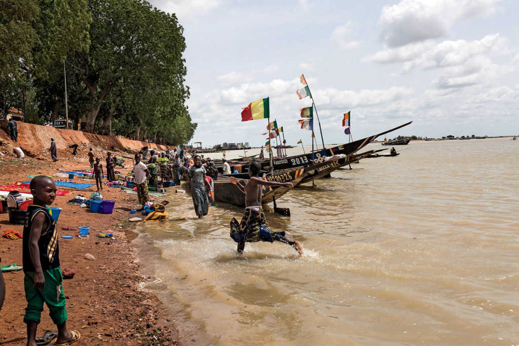 The Niger River: the books' conduit to safety and the author's route back into the conflict zone. Photo: Marco Di Lauro/Reportage by Getty Images